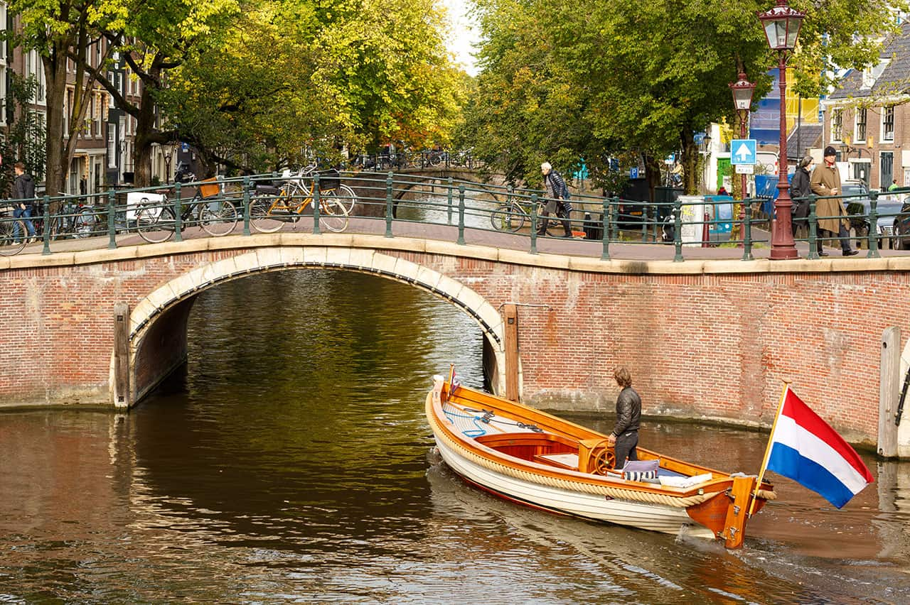 Photo canal Amsterdam with boat